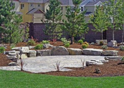 Basalt Boulder Seating Wall and Paver Patio