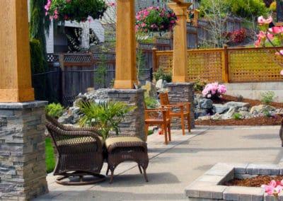 Cedar Pergola with Stone Columns and Landscape