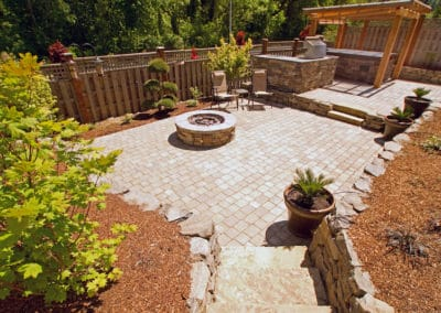 Outdoor Space with Stone Steps, Terraces, Pergola, Firepit and Pavers