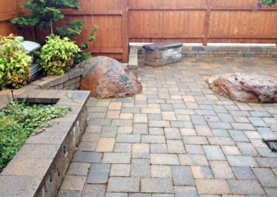 Pavers With Boulders And Wall