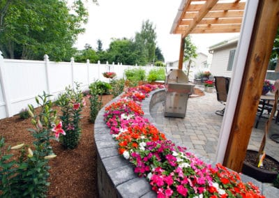 Tegula Block Wall Planter with Pergola and Paver Patio