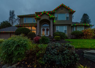 colored-lights-on-two-story-residential-home