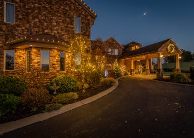 residential-home-with-landscape-lighting-and-wreath