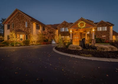 warm-white-lights-on-residential-home-and-landscaping
